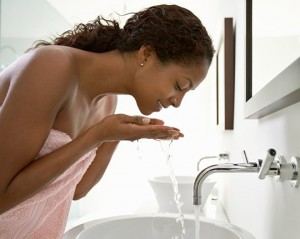 woman-dark-skin-washing-face